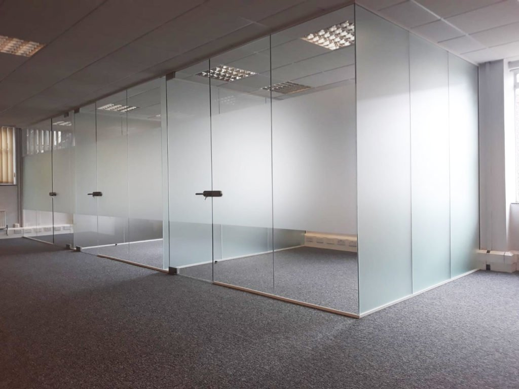 Glass office with frosted manifestation